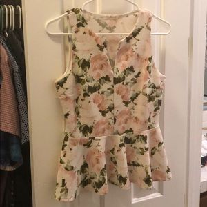 Sleeveless floral peplum top